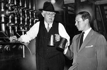 Herbert Leisy and brewmaster Carl Faller sample lager, 1939