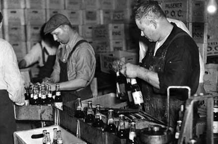 Pilsener Brewery workers pack cases of P.O.C. beer, 1933