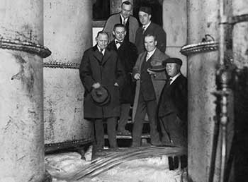 Prohibition agents watch beer storage tanks emptied at Leisy Brewery, 1923