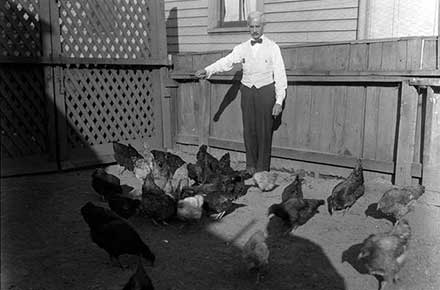 Dudley S. Humphrey II feeding his chickens