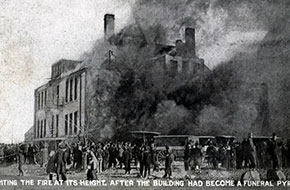 Fighting the fire at its height. After the building had become a funeral pyre.