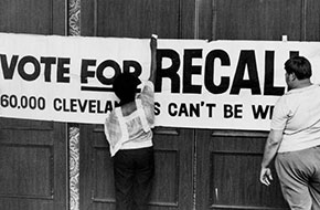 Supporters of the effort to recall Dennis Kucinich hang a sign Aug. 13, 1978.