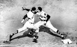 Lou Boudreau of the Cleveland Indians runs to first base in the 2nd World Series Game - 1948