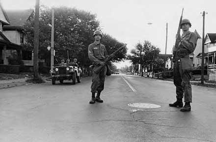 Ohio National Guardsman patrolling Hough Avenue during the daytime on July 23, 1966