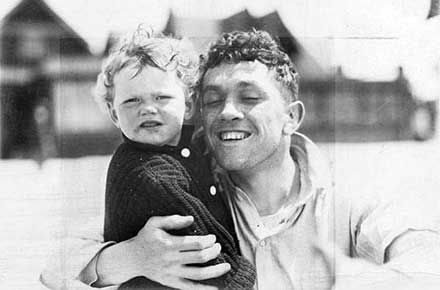 Champion boxer Johnny Kilbane with his daughter, Mary, 1913.