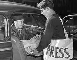 Cleveland Press news carrier receives supply of papers, 1946
