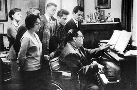 Darius Milhaud with students at piano