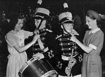 Girls helping Band members