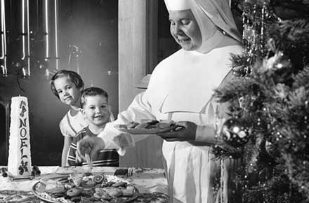 Sister working on Christmas cookies, 1959