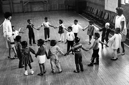 Children play games at Friendly Inn Settlement House, 1967