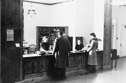 Librarian Mary Lee Scriven at Circulation Desk, Shaker Heights Public Library, circa 1938.