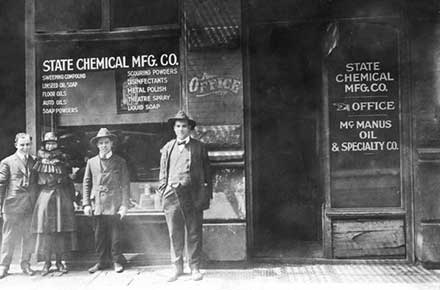 Jay Zucker and others in front of State Chemical building on East 2nd Street, 1920