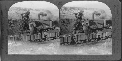 Digging Iron Ore With Steam Shovel and Dumping on Train, Open-pit Iron Mine, Minn.