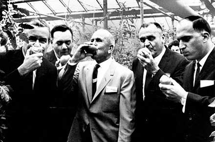 Ohio Gov. James A. Rhodes enjoys a tomato tasting at a local Cleveland area greenhouse, 1966.